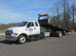 2005 FORD Model F-650XLT, Super Duty Pro Loader Extended Cab Single Axle Rollback Truck